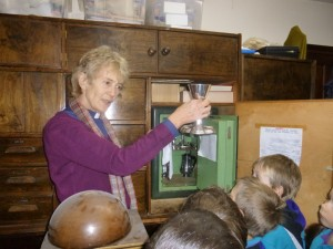 Liz shows the Beavers the silverware